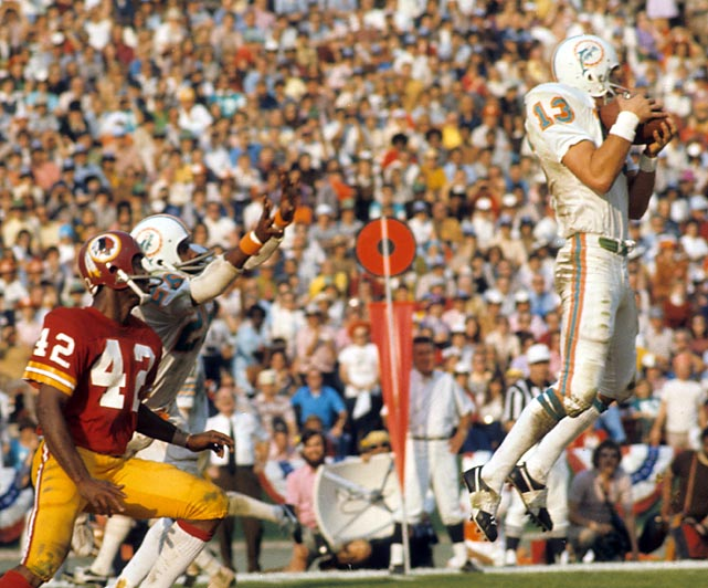 The Dolphins beat Washington 14-7 in Super Bowl VII in Los Angeles, completing a 17-0 season -- the only perfect record in NFL history. Safety Jake Scott intercepted two passes and became the first defensive back to be named MVP in a Super Bowl.