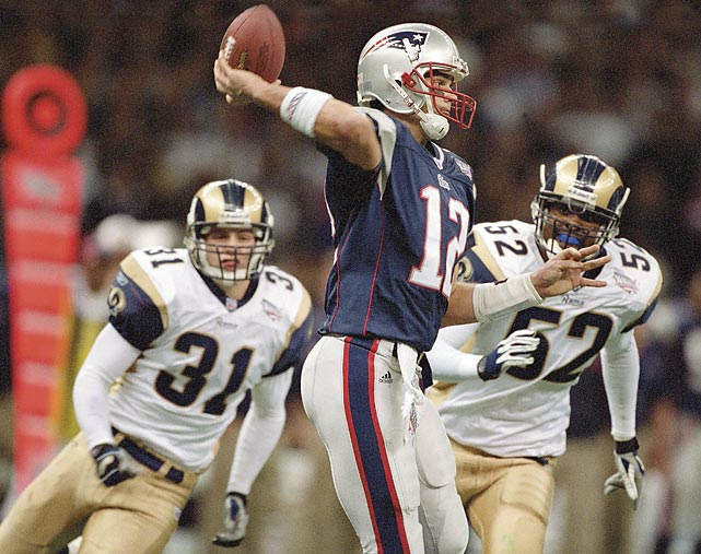 """After two previous Super Bowl losses in the Patriots' history, the third time was the charm. In Super Bowl XXXVI, New England was quarterbacked by a sixth-round draft pick in relative unknown Tom Brady and was up against the Rams, winners of the game two seasons before, and known as """"The Greatest Show on Turf."""" No one expected the two touchdown underdogs to do much, let alone win, but a 48-yard Adam Vinatieri field goal as time expired won the Pats their first title, 20-17."""