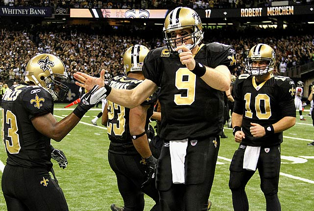 Quarterback Drew Brees breaks Dan Marino's 27-year-old record for passing yards in a single season when he throws a 9-yard scoring pass to Darren Sproles to cap a 45-16 victory over Atlanta. Brees finishes the season with 5,476 passing yards.