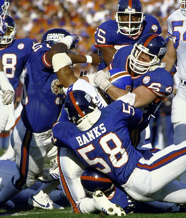 The Giants defeated the Denver Broncos in SB XXI, but no other series epitomized New York's dominance more than a second-quarter stop of John Elway's team. On first-and-goal from the one-yard line, Lawrence Taylor, Harry Carson and Carl Banks each recorded consecutive tackles for loss or no gain and Denver missed the ensuing 23-yard field goal to improve its 10-7 lead. Phil Simms would complete 22-of-25 pass attempts in what became a 39-20 rout for the franchise's first Super Bowl win.