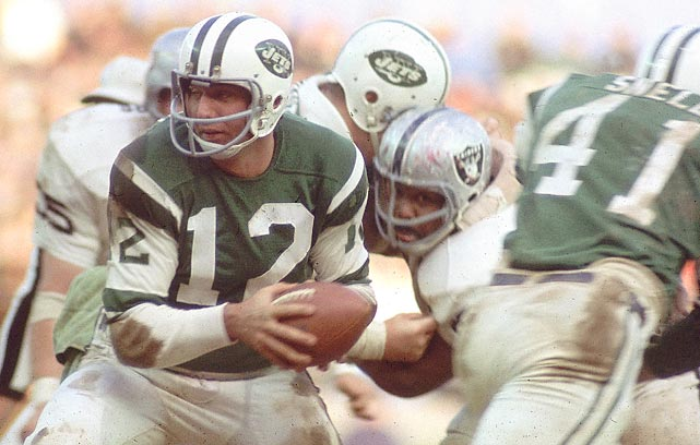 Many Jets say the team really won the '68 world championship in a bitter 27-23 survival test over the Oakland Raiders in the AFL title game. With winds gusting more than 20 mph and the Shea Stadium grass all but gone, the Jets rally in the fourth quarter as Joe Namath hits Don Maynard with a six-yard TD pass for the winning points.