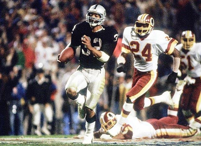 "After relocating to Los Angeles following the 1981 championship season, the Raiders were back in the Super Bowl just a few years later and faced Joe Gibbs' favored defending Super Bowl champion Redskins. In what is remembered as ""Black Sunday,"" the Silver and Black jumped out to a 21-3 halftime lead and never looked back. Marcus Allen was named the game's MVP after racing to two touchdowns and a then-record 191 total yards, and Los Angeles took Super Bowl XVIII, 38-9."
