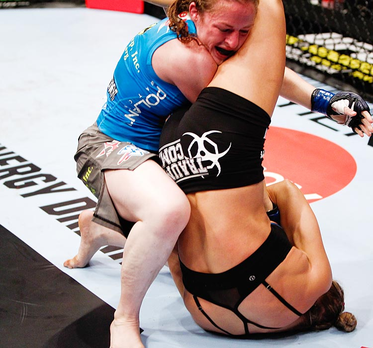 Ronda Rousey secures an arm bar submission against Sarah Kaufman during their Strikeforce bout.