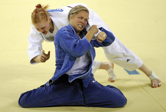 Rousey (blue) and Germany's Annett Boehm compete in their women's 70 kg judo bronze medal match at the 2008 Beijing Olympic Games. Rousey would win the match and the bronze.