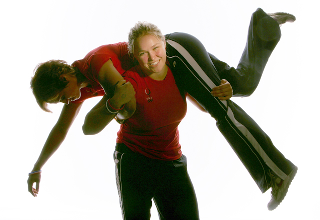 Rousey throws Valerie Gotay over her shoulder as she poses for a portrait during the 2008 U.S. Olympic Team Media Summitt in Chicago.