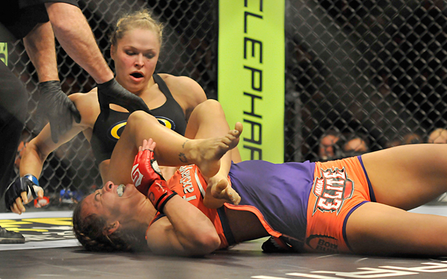 Rousey reacts after submitting Tate during their bantamweight bout in Columbus, Ohio.