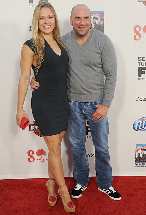 Rousey poses with Dana White at the Sons of Anarchy season 5 premiere screening in Los Angeles.