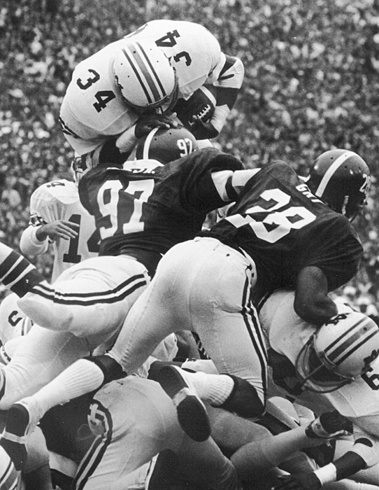 Jackson dives over a pile at Alabama's Legion Field.