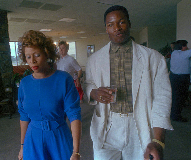 Jackson leaves a press conference with his fiancee Linda Garrett after announcing he would play part-time with the L.A. Raiders.