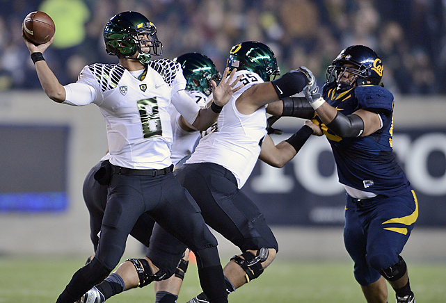Marcus Mariota tied a school-record with six touchdown passes as Oregon crushed Cal one day before likely ascending to the top spot in the AP and Coaches polls. The Ducks have scored at least 40 points during its 13-game winning streak, setting a new FBS record.