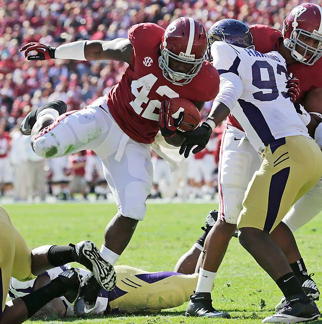 Alabama may be on the outside of the BCS title picture looking in after last week's upset loss to Texas A&M, but the Crimson Tide haven't lost focus. Eddie Lacy (pictured) rushed for three touchdowns on a mere 10 carries and the Alabama defense held Western Carolina to 178 net yards and eight first downs.