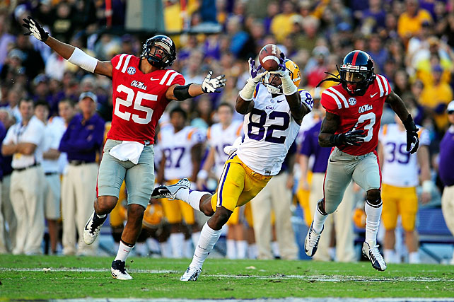 Ole Miss seemed on the verge of pulling off the upset, but LSU came through in the fourth quarter to keep its BCS at-large hopes alive. Zach Mettenberger threw for 282 yards, Spencer Ware ran for 77 yards and three touchdowns and Travis Dickson, James Wright (pictured) and Jarvis Landry all tallied at least 60 receiving yards. The play of the game came on special teams, though. Odell Beckham returned a punt 89 yards to the end zone to spur LSU's comeback.