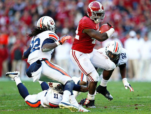 Alabama is headed to the SEC championship game. The Tide shut out the Tigers in the Iron Bowl to keep their BCS title hopes intact. AJ McCarron threw for 216 yards and four touchdowns, and running back Eddie Lacy (pictured) racked up 131 rushing yards and two scores. The 'Bama defense was also stifling. The Tide allowed a mere 163 total yards and forced three turnovers.