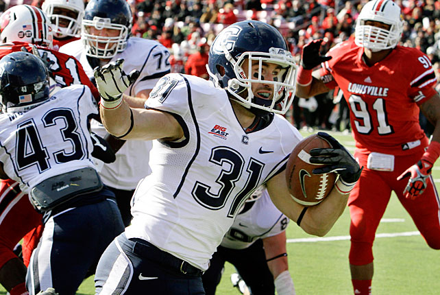After starting 9-0, Louisville has now lost two consecutive games. The Huskies took down the Cardinals behind a strong performance from running back Lyle McCombs, who recorded 29 carries for 133 yards in UConn's upset win. But things didn't come easy. After Nick Williams (pictured) scored from three yards out to give the Huskies a 10-point lead in the second quarter, Louisville mounted a comeback, eventually tying the game when Teddy Bridgewater connected with DeVante Parker from six yards out with 21 seconds left. UConn won in triple overtime on a 30-yard Chad Christen field goal.