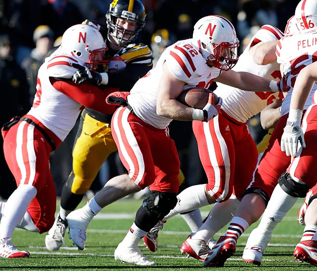 Making his long-awaited return from a knee injury, Nebraska running back Rex Burkhead (pictured) scored the go-ahead touchdown in the Huskers victory over Iowa on Friday. Burkhead finished 69 rushing yards and a score, and Nebraska clinched the Legends Division title to earn a berth in the Big Ten championship game.