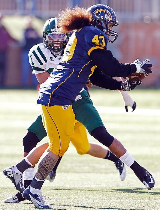 Kent State senior linebacker C.J. Malauulu (pictured) returned an interception 33 yards to the end zone -- 12 seconds after a Trayion Durham touchdown -- and the surging Golden Flashes completed a perfect season in the MAC with their 10th straight win, over Ohio, on Friday. Kent State will play Northern Illinois in the MAC title game next weekend.
