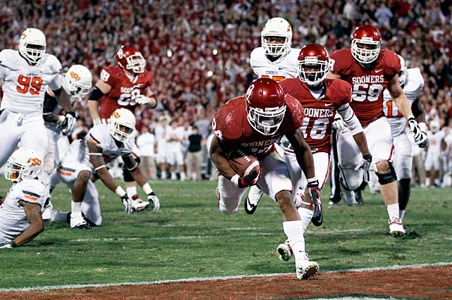 In a contest full of momentum swings, Oklahoma captured this year's Bedlam game in dramatic fashion. Oklahoma State took a late 48-45 lead after standout performances from Joseph Randle (113 rushing yards, four touchdowns) and Josh Stewart (150 receiving yards, one score), but the Sooners forced overtime on Blake Bell's four-yard run with four seconds left. Brennan Clay (pictured) scored the game-winner on an 18-yard dash, and Oklahoma quarterback Landry Jones finished 46-of-71 with 500 passing yards.