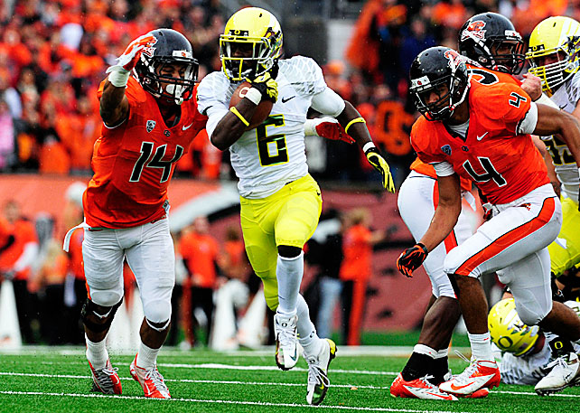 Oregon certainly didn't show any hangover effects from last week's loss against Stanford. The Ducks dominated the Civil War from start to finish, a game in which Marcus Mariota threw for 140 yards and a touchdown. Still, Oregon's ground game stole the show. Kenjon Barner ran for 198 yards and two scores, De'Anthony Thomas (pictured) scampered for 122 yards and three touchdowns and Mariota rushed for 85 yards and a touchdown.