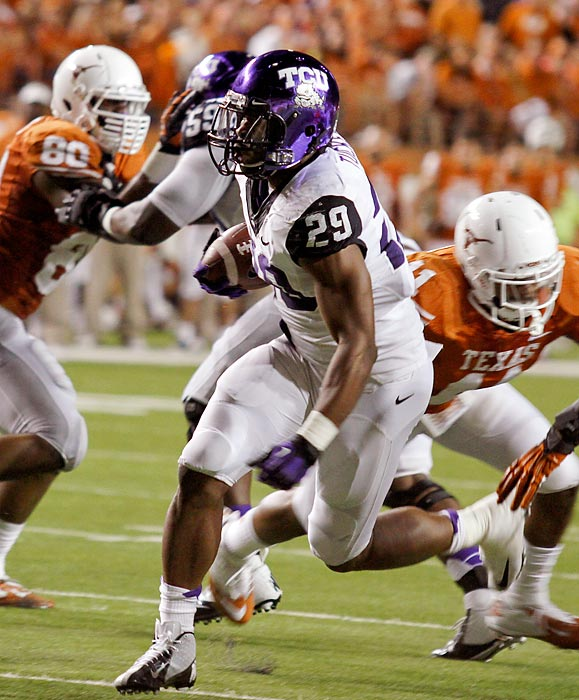 TCU may have finally arrived in the Big 12. In a Thanksgiving night showcase, the Horned Frogs topped Texas to earn their biggest win to date in their new league. Matthew Tucker (pictured) rushed for 57 yards and two touchdowns, Jared Oberkrom kicked two field goals and TCU's defense generated four turnovers -- three coming from Texas quarterback David Ash in the first half.