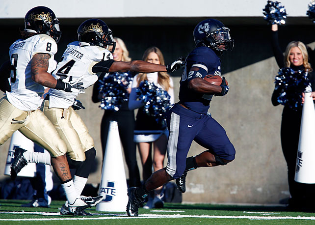 One week after upsetting Louisiana Tech in overtime, Utah State finished 6-0 in the WAC by steamrolling Idaho on Saturday. Chuckie Keeton passed for 133 yards and two touchdowns, Kerwynn Williams (pictured) rushed for 110 yards and a score and the Aggies defense shut down the Vandals. Utah State produced four Idaho turnovers, including Will Davis' 59-yard pick-six in the second quarter.