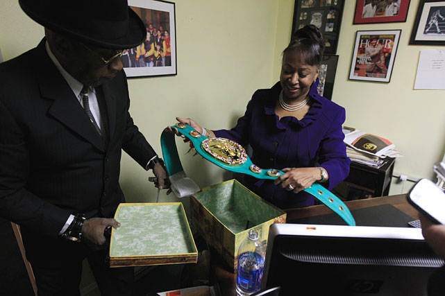 Steward's sister Sylvia Steward-Williams goes through memorabilia on Tuesday at the trainer's office.