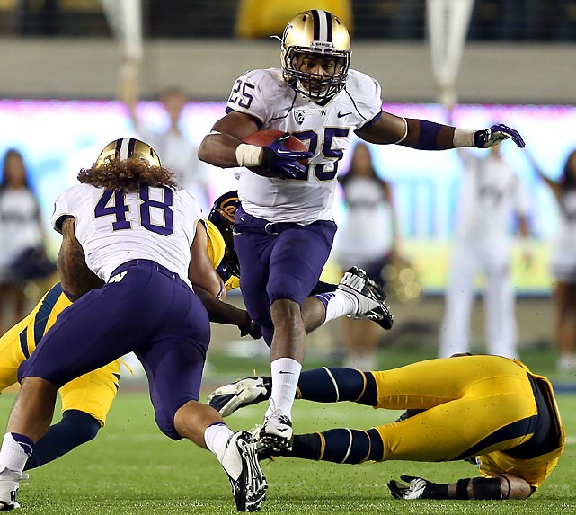 Washington's Bishop Sankey shoots through a gap of California defenders during the Huskies' Friday night win over the Bears.