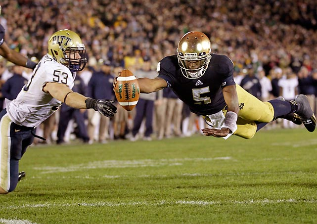 Notre Dame quarterback Everett Golson dives into the end zone in front of Pittsburgh linebacker Joe Trebitz for a two-point conversion to tie the score late in the fourth quarter. Despite struggling most of the game, Golson showcased some fourth-quarter magic to help preserve the Irish's undefeated season.