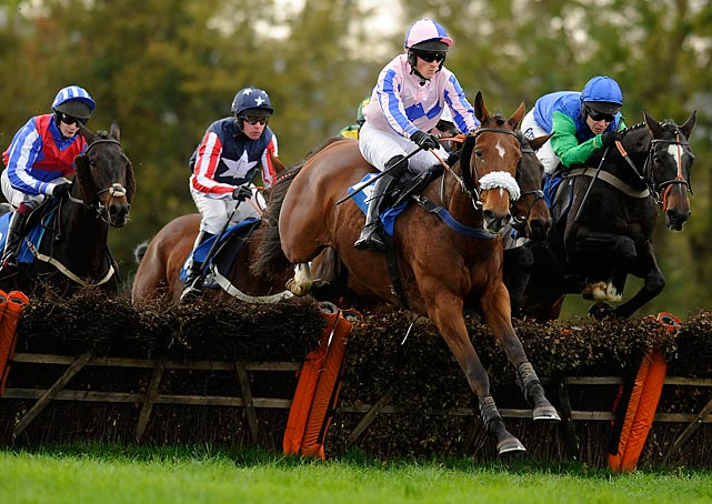 Giles Hawkins rides Key To Milan clear a hurdle before winning the Christmas Parties at Taunton Racecourse Handicap Hurdle Race on Oct. 30 in Taunton, England.