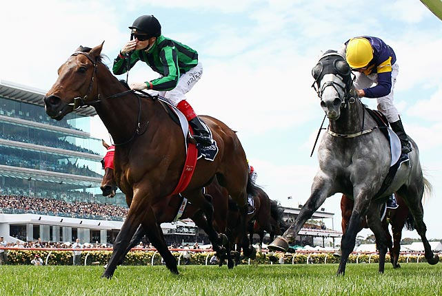 Craig Williams riding Alcopop (3) crosses the line to win race five of the Longines Mackinnon Stakes during Victoria Derby Day at Flemington Racecourse on Nov. 3 in Melbourne, Australia.