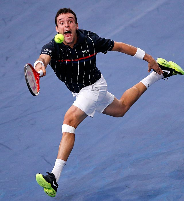 Roberto Bautista-Agut of Spain returns the ball to Paul-Henri Mathieu of France during the Paris Masters.