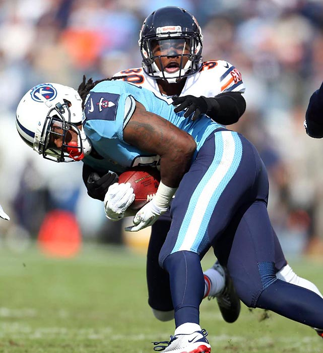 Chicago's D.J. Moore wraps up Tennessee's Chris Johnson. The Bears' defense continued its torrid season, forcing five turnovers and improving to  16 in the turnover category during its 51-20 win over the Titans.