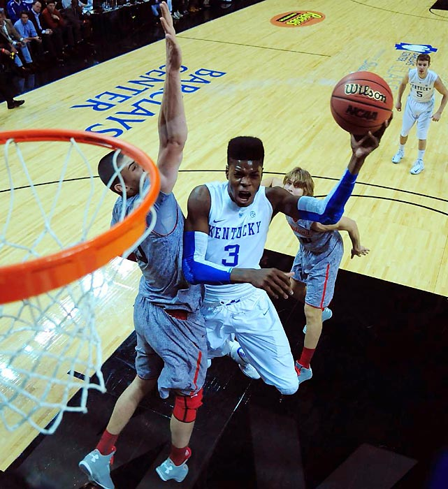 Flat-topped Kentucky freshman Nerlens Noel attacks the paint against Maryland's Alex Len during the Wildcats' 72-69 squeaker over the Terrapins to open the season.