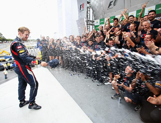 After clinching the 2012 Formula One title at Sao Paulo's Brazilian Grand Prix, Sebastian Vettel of Germany celebrated with his Red Bull Racing crew.