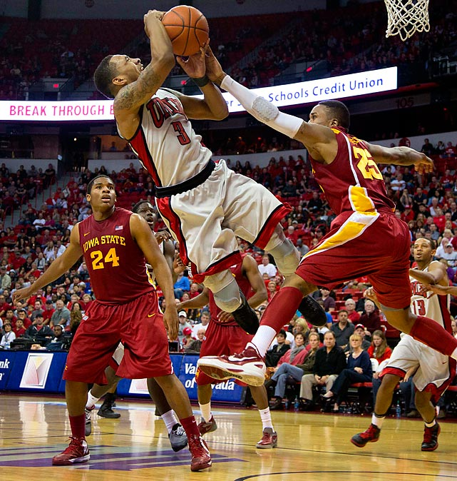 Anthony Marshall of UNLV gets fouled by Iowa State's Tyrus McGee in Las Vegas. The favored Rebels won 82-70.