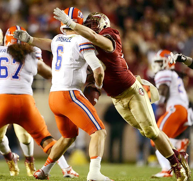 Florida State's Bjoern Werner moves in for a sack against Florida quarterback Jeff Driskel. Werner had 3.5 sacks that game, but his Seminoles still lost, 37-26.