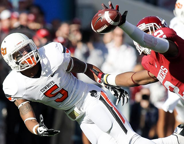 Oklahoma's Julian Wilson blocks a pass during the Sooners' rivalry game against the Oklahoma State Cowboys. The Sooners won in overtime, 51-48.