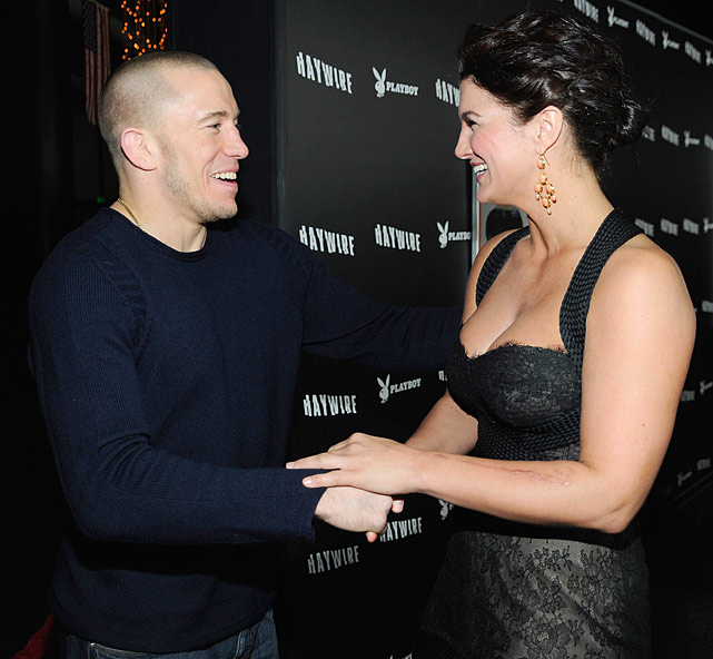 UFC welterweight champion Georges St-Pierre and actress Gina Carano arrive at Relativity Media's premiere of  Haywire  co-hosted by  Playboy  held at DGA Theater on January 5, 2012 in Los Angeles, Calif.