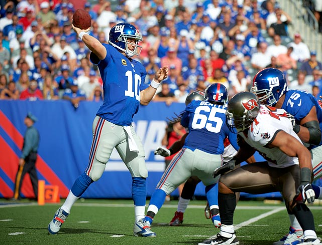 Down 24-13 at the half and wanting to avoid a 0-2 start to the season, New York rallied behind Eli Manning's 510 passing yards to come out on top in this shootout in the Meadowlands. In a contest marred by a postgame quarrel between head coaches Tom Coughlin and Greg Schiano, the final 6:48 included four touchdowns -- two from Manning -- on his near-record day. The Giants' play caller, in tossing three scores to go with three second-quarter picks, came within three yards of the team's all-time passing record of 513 yards, set by Phil Simms versus the Bengals in 1985.