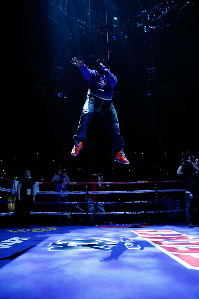Rapper 50 Cent was lowered to the center of the ring before the WBA interim super featherweight title fight between Yuriorkis Gamboa and Michael Farenas on the Pacquiao-Marquez undercard.