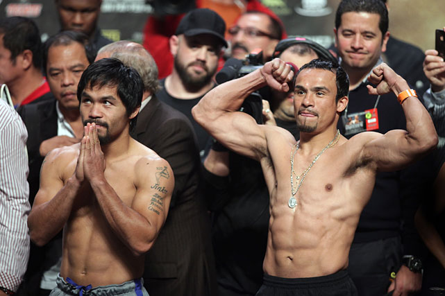 Pacquiao and Marquez play to their fans after Friday's weigh-ins at the MGM Grand Garden Arena. The longtime rivals meet for a fourth time in eight years Saturday night.