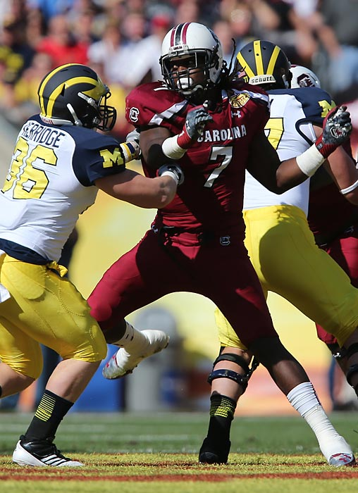 South Carolina and Michigan played a thrilling Outback Bowl that the Gamecocks won on a last-second Bruce Ellington touchdown, but Clowney's hit on running back Vincent Smith overshadowed everything else. The impact launched Smith's helmet 11 yards behind the line of scrimmage, jarred the ball loose (Clowney recovered the fumble) and sparked a slew of internet gifs, memes and proclamations regarding where the play ranks among the most memorable in college football history.