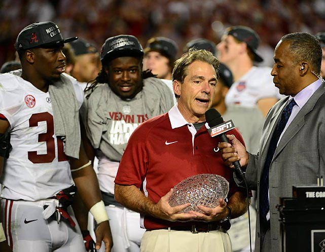 Nick Saban accepted his fourth crystal football of his coaching career. Saban won the BCS national title with LSU in 2003 before winning three with Alabama.