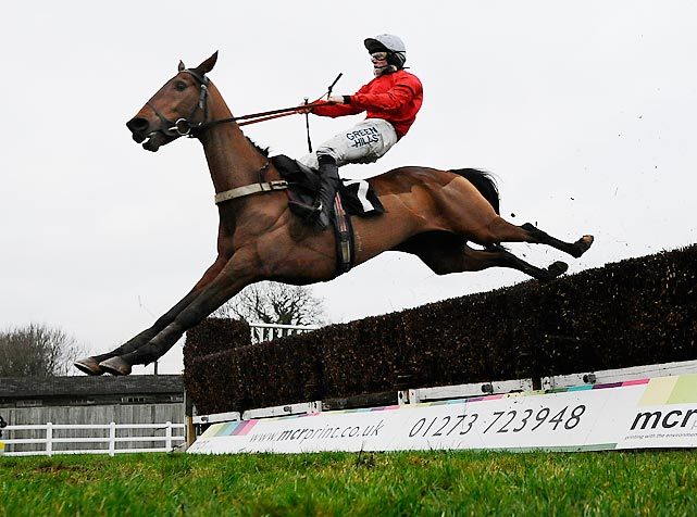 Joshua Moore, riding Well Refreshed, clears the last obstacle to win the At The Races Sussex National in Plumpton, England.
