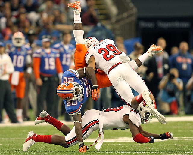 Louisville strong safety Hakeem Smith breaks up a pass with his hit on Florida tight end Omarius Hines in the Sugar Bowl. The Cardinals stunned the Gators with a 33-23 upset.