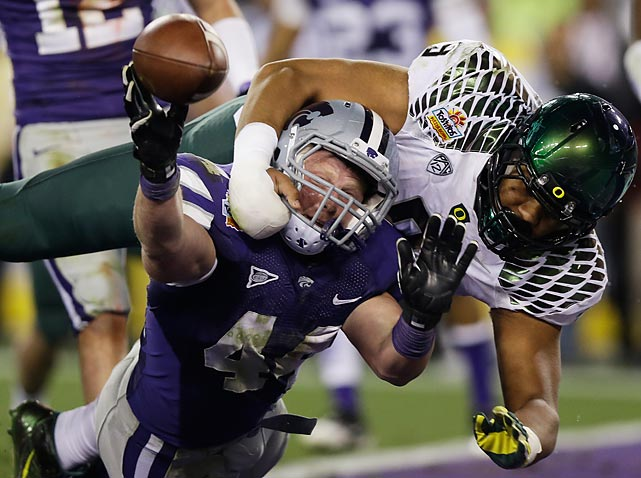 Oregon's Byron Marshall brings down Kansas State's Ryan Mueller in the end zone after the Wildcats blocked the Ducks' extra point attempt. Because Kansas State recovered the blocked kick outside of its end zone before running backward, the play resulted in a safety for Oregon.