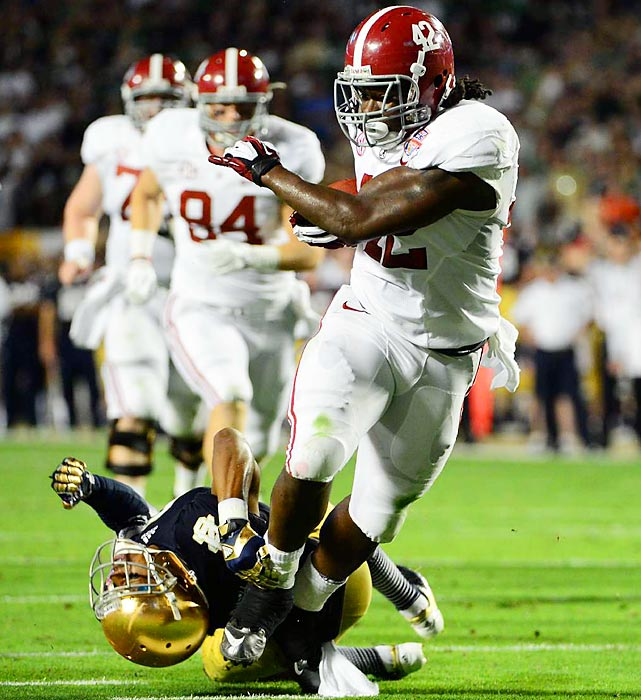 Alabama running back Eddie Lacy breaks away from a tackle in the BCS National Championship game. Lacy gained 140 yards on 20 carries with a touchdown.