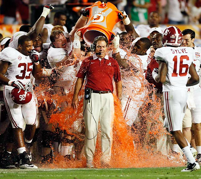 Alabama head coach Nick Saban receives his Gatorade shower as the Crimson Tide finish off a 42-14 victory over Notre Dame in the BCS National Championship Game in Miami.