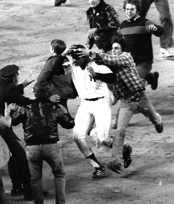 Chris Chambliss' leadoff homer in the bottom of the ninth off Kansas City's Mark Littell snapped a 6-6 tie and ended New York's 12-year pennant drought. Chambliss needed a police escort to reach home plate after pandemonium broke out at Yankee Stadium.