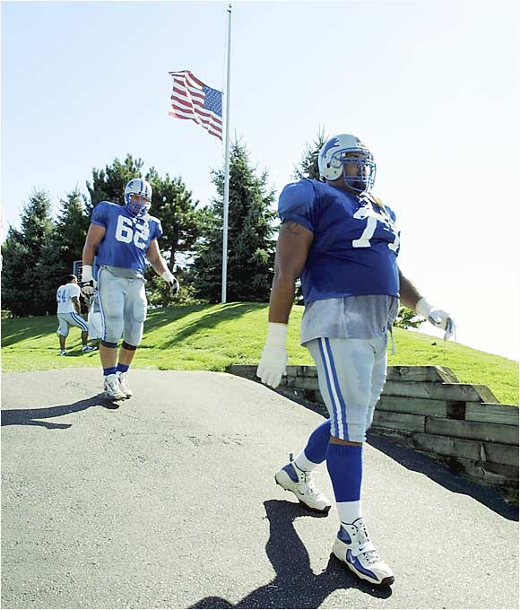 A flag flying at half-staff greeted these players as they left the practice field on the day after the attacks.