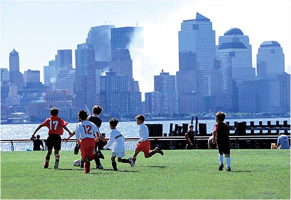 The smoky and diminished New York skyline served as the backdrop for a Saturday youth soccer game in Hoboken, N.J.